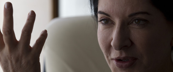 """Performance artist Marina Abramovic speaks during an interview at the Rio Film Festival in Rio de Janeiro, Brazil, Thursday, Oct. 4, 2012. The Belgrade-born artist is best known for her piece """"The Artist Is Present,"""" which in 2010 saw her sit silent and motionless for 736.5 hours opposite a parade of strangers at New York's Museum of Modern Art. The film is playing at the 2012 Rio de Janeiro International Film Festival. (AP Photo/Silvia Izquierdo)"""
