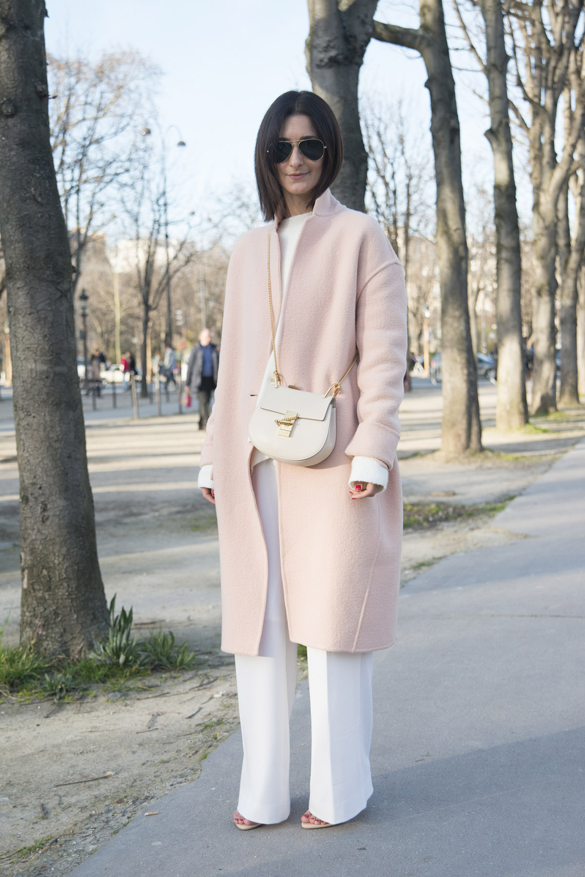 PARIS, FRANCE - MARCH 08: Store owner and fashion blogger Golestaneh wears a Celine coat, Zara top and shoes, Fall Winter Spring Summer trousers, Chloe bag and Ray Ban sunglasses on day 6 of Paris Collections: Women on March 08, 2015 in Paris, France. (Photo by Kirstin Sinclair/Getty Images)